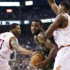 Toronto Raptors\' Amir Johnson, center, drives between Cleveland Cavaliers\' Alonzo Gee (33) and Tristan Thompson during the first half of an NBA basketball game, Saturday, Jan. 26, 2013, in Toronto. (AP Photo/The Canadian Press, Chris Young)