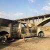 An Iraqi police truck is seen burned on a street of the northern city of Mosul, Iraq, Sunday, July 6, 2014. Iraqi officials are working to determine the authenticity of a video that purportedly shows the leader of the Islamic extremist group that has seized large swaths of the country delivering a sermon this week in Mosul, the nation\'s second-largest city, authorities said Sunday. (AP Photo)