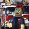 The fire department\'s inflatable mascot character, Big Jim, walked with the department\'s delegation in the parade. The city of Midwest City teamed with civic leaders and local merchants to display their appreciation for veterans and active military forces by staging a hour-long Veteran\'s Day parade that stretched more than a mile and a half along three of the city\'s busiest streets Monday morning, Nov. 12, 2012. Hundreds of people lined the parade route, many of them waving small American flags that had ben distributed by volunteers who marched near the front of the parade. A fly-over performed by F-16s from the138th Fighter Wing, Oklahoma Air National Guard unit in Tulsa thrilled spectators. Five veterans representing military personnel who served in five wars and military actions served as Grand Marshals for the parade. Leading the parade was the Naval Reserve seven-story American flag, carried by 100 volunteers from First National Bank of Midwest City, Advantage Bank and the Tinker Federal Credit Union. The flag is 50 feet by 76 feet, weighs 110 pounds and was sponsored by the MWC Chapter of Disabled American Veterans. Photo by Jim Beckel, The Oklahoman