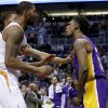 Photo - Los Angeles Lakers' Nick Young, right, has words with Phoenix Suns' Marcus Morris and Markieff Morris, rear, during the first half of an NBA basketball game Wednesday, Jan. 15, 2014, in Phoenix. Young was ejected from the game along with Suns' Alex Len. (AP Photo/Ross D. Franklin)