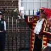 Tony Appleton, a town crier, rings his bell as he announces the birth of the royal baby, outside St. Mary\'s Hospital exclusive Lindo Wing in London, Monday, July 22, 2013. Palace officials say Prince William\'s wife Kate has given birth to a baby boy. The baby was born at 4:24 p.m. and weighs 8 pounds 6 ounces. The infant will become third in line for the British throne after Prince Charles and William. (AP Photo/Lefteris Pitarakis)
