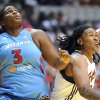 Indiana Fever\'s Erlana Larkins, right, battles Atlanta Dream\'s Courtney Paris for rebounding position during their WNBA basketball game, Saturday, May 19, 2012, in Indianapolis. (AP Photo/The Indianapolis Star, Rob Goebel) ORG XMIT: ININS301