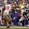 New England Patriots wide receiver Wes Welker (83) runs from New York Giants linebacker Michael Boley, left, during the first half of the NFL Super Bowl XLVI football game, Sunday, Feb. 5, 2012, in Indianapolis. (AP Photo/Marcio Jose Sanchez) ORG XMIT: SB242