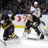 Photo - Buffalo Sabres' Tyler Ennis (63) and Ryan Miller (30) each get a glove up as Phoenix Coyotes' Mike Ribeiro (63) watches the rebound during the second period of an NHL hockey game in Buffalo, N.Y., Monday, Dec. 23, 2013. (AP Photo/Gary Wiepert)