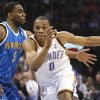 OKLAHOMA CITY THUNDER / NEW ORLEANS HORNETS / NBA BASKETBALL Oklahoma City Thunder guard Russell Westbrook drives past New Orleans\' Marcus Thornton during the Thunder - Hornets game March 10, 2010 in the Ford Center in Oklahoma City. BY HUGH SCOTT, THE OKLAHOMAN ORG XMIT: KOD