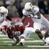 Texas A&M\'s Steven Terrell (21) and Dustin Harris (22) bring down Oklahoma\'s Jalen Saunders (18) during the college football Cotton Bowl game between the University of Oklahoma Sooners (OU) and Texas A&M University Aggies (TXAM) at Cowboy\'s Stadium on Friday Jan. 4, 2013, in Arlington, Tx. Photo by Chris Landsberger, The Oklahoman