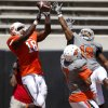 OSU\'s Oklahoma State\'s Brodrick Brown, at right, and Shamiel Gary defend Blake Jackson on an incomplete pass spring football game at Boone Pickens Stadium in Stillwater, Okla., Saturday, April 21, 2012. Photo by Bryan Terry, The Oklahoman