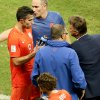 Photo - Netherlands' head coach Louis van Gaal, right, talks to Robin van Persie before extra time, during the World Cup quarterfinal soccer match between the Netherlands and Costa Rica at the Arena Fonte Nova in Salvador, Brazil, Saturday, July 5, 2014. (AP Photo/Themba Hadebe)