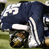 Edmond North\'s Lance Dixon brings down Midwest City\'s Cedric Fair during a high school football game at Wantland Stadium in Edmond, Thursday, October 25, 2012. Photo by Bryan Terry, The Oklahoman