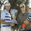 Photo - Bubba Watson holds the winner's trophy with his wife Angie and son Caleb after his victory in the Northern Trust Open golf tournament at Riviera Country Club in the Pacific Palisades area of Los Angeles, Sunday, Feb. 16, 2014. Watson carded a 15-under-par 269, two strokes ahead of the second-place finisher. (AP Photo/Reed Saxon)