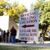 A sign guides voters to a polling location as they line up to cast their votes Tuesday, Nov. 6, 2012, in Dallas. After a grinding presidential campaign, Americans head into polling places across the country. (AP Photo/Tony Gutierrez)