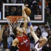 Los Angeles Clippers\' Blake Griffin (32) blocks the shot of Phoenix Suns\' Marcin Gortat (4), of Poland, during the first half in an NBA basketball game on Thursday, Jan. 24, 2013, in Phoenix. (AP Photo/Ross D. Franklin)