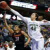 Baylor\'s Brittney Griner (42) blocks the shot of Oklahoma State\'s Kendra Suttles (31) during the Big 12 tournament women\'s college basketball game between Oklahoma State University and Baylor at American Airlines Arena in Dallas, Sunday, March 10, 2012. Photo by Bryan Terry, The Oklahoman