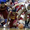 Photo -   Iowa State's Melvin Ejim, left, Tyrus McGee, center, and UNLV's Mike Moser, right, reach for the loose ball during the second half of an NCAA college basketball game, Saturday, Nov. 24, 2012, in Las Vegas. UNLV won 82-70. (AP Photo/Julie Jacobson)