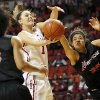 Photo - Oklahoma's Nicole Kornet (1) tries to get the ball past Cal State Northridge's Jasmine Johnson (35) and Janae Sharpe (3) in the first half during a women's college basketball game between the University of Oklahoma (OU) and Cal State Northridge at the Lloyd Noble Center in Norman, Okla., Saturday, Dec. 29, 2012. Photo by Nate Billings, The Oklahoman