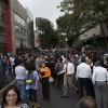 Photo - People gather in the street after an earthquake was felt in Mexico City, Thursday, May 8, 2014. A strong earthquake on the Pacific coast shook the capital, sending frightened office workers streaming into the streets away from high-rise buildings. (AP Photo/Rebecca Blackwell)