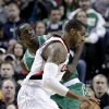 Portland Trail Blazers forward LaMarcus Aldridge, right, drives to the basket past Boston Celtics forward Brandon Bass during the first quarter of an NBA basketball game in Portland, Ore., Sunday, Feb. 24, 2013. (AP Photo/Don Ryan)