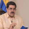 In this photo provided by Miraflores Presidential Press Office, Venezuela\'s Vice President Nicolas Maduro holds a miniature copy of Venezuela\'s constitution as he gives an interview on state television in Caracas, Venezuela, Friday, Jan. 4, 2013. Maduro said Friday that President Hugo Chavez could be sworn in by the Supreme Court later on if he\'s not able to take the oath of office before lawmakers on Jan. 10 because of his struggle with cancer, dismissing the argument by some opposition leaders that new elections must be called if Chavez doesn\'t take office as scheduled on Thursday. (AP Photo/Miraflores Presidential Office)