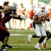 OSU running back Keith Toston runs through a hole in the ASU defense in the first half during the college football game between Oklahoma State University (OSU) Cowboys and Arkansas State University (ASU) Indians at War Memorial Stadium in Little Rock, Ark., Saturday September 9, 2006. BY MATT STRASEN, THE OKLAHOMAN. ORG XMIT: KOD