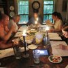 Photo -   In this photo taken Sunday Aug. 21, 2011 the cast and crew use candles to go over the script after loosing power from a powerful thunderstorm in New Hampton, N.H. Thirty years after the academy award winning movie,