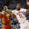Texas\' Demarcus Holland (2) knocks the ball away from Oklahoma\'s Isaiah Cousins (11) during an NCAA college basketball game in Norman, Okla., Monday, Jan. 21, 2013. (AP Photo/The Oklahoman, Nate Billings)