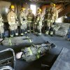 Major Brian Arnold (far right) gives a safety briefing to firefighters before beginning a live fire drill for fire department recruit training at the Eastern Oklahoma County Vo-Tech in Choctaw, OK, Monday, Jan. 30, 2012. By Paul Hellstern, The Oklahoman