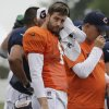 Photo - Chicago Bears quarterback Jay Cutler wipes his face during NFL football training camp Wednesday, July 31, 2013, in Bourbonnais, Ill. (AP Photo/Nam Y. Huh)