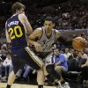 San Antonio Spurs\' Danny Green (4) drives past Utah Jazz\' Gordon Hayward (20) during the third quarter of an NBA basketball game, Saturday, Nov. 3, 2012, in San Antonio. (AP Photo/Eric Gay)