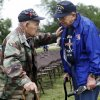 World War II veteran Art Levine (left) speaks with fellow World War II veteran Stan Newman (right) at the 45th Infantry Division Memorial Day ceremony in Oklahoma City, Monday, May 26, 2014. Both Levine and Newman served in the European theatre of the war. Levine was a member of the 101st Airborne and Newman flew a P51 Mustang.