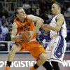Oklahoma State\'s Phil Forte, left, has his drive to the basket disrupted by TCU \'s Kyan Anderson (5) in the first half of an NCAA basketball game on Wednesday, Feb. 27, 2013, in Fort Worth, Texas. (AP Photo/Tony Gutierrez) ORG XMIT: TXTG105