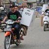 Photo - Indonesia men use motorcycles to distribute ballot boxes to polling stations in Jakarta, Indonesia, Tuesday, July 8, 2014. Indonesia elects a new president on Wednesday with two clear choices: On the one side is a wildly popular former furniture maker who is also Jakarta Governor Joko Widodo and on the other is an ex-army general with a dubious record and once the son-in-law of former dictator Suharto, Lt. Gen. (ret.) Prabowo Subianto. (AP Photo/Tatan Syuflana)