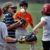 Photo -  Jacen Jackson, 9, tries to tag Ben Wicker, 10, as kids participate in a baseball camp sponsored by Norman Parks and Recreation Department. PHOTO BY STEVE SISNEY, THE OKLAHOMAN   STEVE SISNEY -