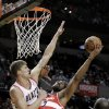 Washington Wizards guard John Wall, right, shoots against Portland Trail Blazers center Meyers Leonard during the first quarter of an NBA basketball game in Portland, Ore., Monday, Jan. 21, 2013. (AP Photo/Don Ryan)