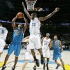 Devin Brown of the Hornets tries shoot by Oklahoma City\'s Jeff Green during the NBA basketball game between the Oklahoma City Thunder and the New Orleans Hornets at the Ford Center in Oklahoma City on Friday, Nov. 21, 2008. BY BRYAN TERRY, THE OKLAHOMAN