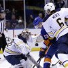 Buffalo Sabres goalie Ryan Miller, left, defends against a shot by New York Islanders\' Casey Cizikas, center, while Mike Weber looks on during the second period of the NHL hockey game Saturday, Feb. 9, 2013, in Uniondale, N.Y. (AP Photo/Seth Wenig)