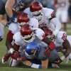 A group of Oklahoma defenders including, from top, Chuka Ndulue (98), Quincy Russell (95), Charles Tapper (91), and Frank Shannon (20), bottom right, bring down KU\'s Jake Heaps (9) during the college football game between the University of Oklahoma Sooners (OU) and the University of Kansas Jayhawks (KU) at Memorial Stadium in Lawrence, Kan., Saturday, Oct. 19, 2013. Oklahoma won 34-19. Photo by Bryan Terry, The Oklahoman