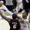 Miami Heat\'s LeBron James (6) shoots against Indiana Pacers\' Roy Hibbert (55) during the second half of Game 3 of the NBA Eastern Conference basketball finals in Indianapolis, Sunday, May 26, 2013. (AP Photo/Michael Conroy)