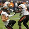 Oklahoma State\'s Zack Craig (23) slides down with the encouragement of Shaun Lewis (11) after Craig intercepted a pass late in the fourth quarter during the AdvoCare Texas Kickoff college football game between the Oklahoma State University Cowboys (OSU) and the Mississippi State University Bulldogs (MSU) at Reliant Stadium in Houston, Saturday, Aug. 31, 2013. OSU won, 21-3. Photo by Nate Billings, The Oklahoman