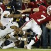 FILE - In this Nov. 21, 2009, file photo, Stanford University running back Toby Gerhart is brought down by a group of California defenders during the fourth quarter of an NCAA college football game in Stanford, Calif. Gerhart may finally have quieted all those skeptics who questioned whether he was too big and powerful to play tailback by becoming a finalist for the Heisman Trophy. (AP Photo/Marcio Jose Sanchez, file) ORG XMIT: NY165