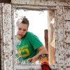 Rebecca Apel, 15, is seen through the broken glass of a door on the side of her family\'s home on SH 74 after a tornado destroyed the house late Tuesday afternoon, May 24, 2011, She and her brother were looking for salvageable items to take with them. Photo by Jim Beckel, The Oklahoman
