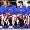 The Tulsa Memorial Chargers wear striped warm-up pants during the Class 5A boys championship high school basketball game against Bishop McGuinness in the state tournament at the Mabee Center in Tulsa, Okla., Saturday, March 9, 2013. Photo by Nate Billings, The Oklahoman