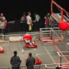 Photo - Robots shoot balls through an opening Friday during the competition, which continues Saturday at Cox Convention Center in Oklahoma City.