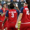 Team USA\'s Kaitlin Cochran (9) is congratulated by Rhea Taylor (3) and Keilani Ricketts (10) after scoring in the first inning during the championship game of the World Cup of Softball between the United States and Australia at ASA Hall of Fame Stadium in Oklahoma City, Monday, July 2, 2012. Photo by Nate Billings, The Oklahoman