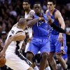San Antonio\'s Tony Parker (9) gets by Oklahoma City\'s Reggie Jackson (15) during Game 2 of the Western Conference Finals in the NBA playoffs between the Oklahoma City Thunder and the San Antonio Spurs at the AT&T Center in San Antonio, Wednesday, May 21, 2014. Photo by Sarah Phipps