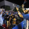 Matt Westphalan, right, cheers with fans at Thunder Alley during the Oklahoma City's first-round series against Dallas. Photo by Garett Fisbeck, For The Oklahoman