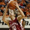 Oklahoma\'s Morgan Hook (10) takes the ball to the hoop against Oklahoma State\'s Toni Young (15) during the Bedlam women\'s college basketball game between Oklahoma State University and the University of Oklahoma at Gallagher-Iba Arena in Stillwater, Okla., Saturday, Feb. 23, 2013. OSU beat OU, 83-62. Photo by Nate Billings, The Oklahoman