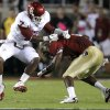 Oklahoma\'s Corey Nelson (7) tries to bring down Florida\'s EJ Manuel (3) during a college football game between the University of Oklahoma (OU) and Florida State (FSU) at Doak Campbell Stadium in Tallahassee, Fla., Saturday, Sept. 17, 2011. Photo by Bryan Terry, The Oklahoman