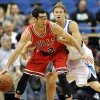 Chicago Bulls\' Kirk Hinrich, left, is pressured by Minnesota Timberwolves\' Luke Ridnour in the first half of an NBA preseason basketball game, Saturday, Oct. 13, 2012, in Minneapolis. (AP Photo/Jim Mone)