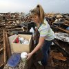 Lacey Tate collects items from the debris of her mother Sharese Tate\'s salon, Trenz, near SW 149th and Western after a tornado struck south Oklahoma City and Moore, Okla., Monday, May 20, 2013. Photo by Nate Billings, The Oklahoman