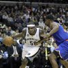 Memphis Grizzlies\' Zach Randolph (50) moves around New York Knicks\' Kurt Thomas during the second half of an NBA basketball game in Memphis, Tenn., Friday, Nov. 16, 2012. The Memphis Grizzlies defeated the New York Knicks 105-95. (AP Photo/Danny Johnston)